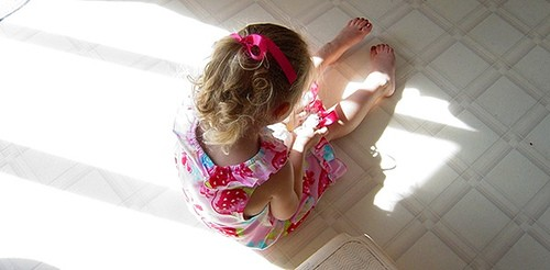 Girl on kitchen floor